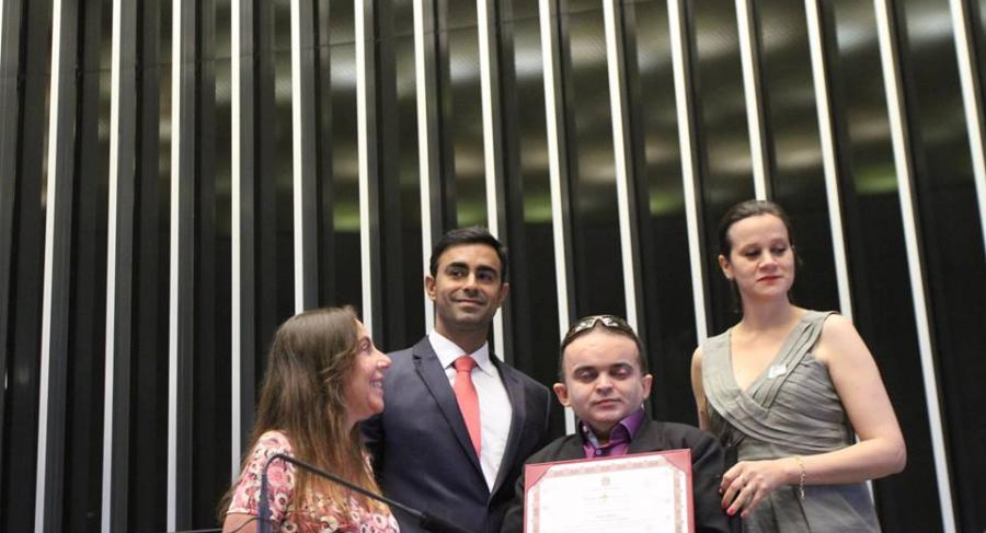 "Alex receiving "" Brasil mais inclusão"" award in the federal capital, Brasilia, at the Parliament."
