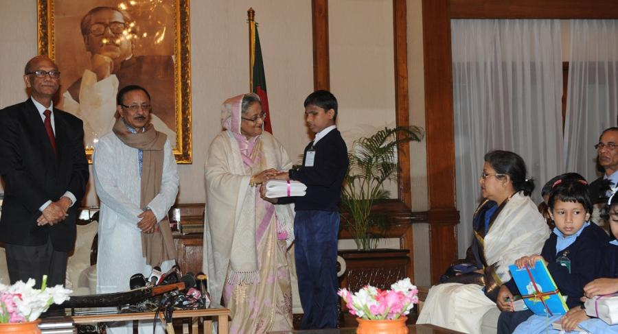 Prime Minister Handing over Accessible Books to the visually impaired Children