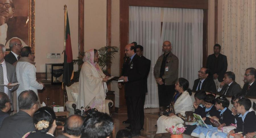Vashkar is Handing over Daisy Books developed by YPSA & a2i  to Prime Minister Sheikh Hasina