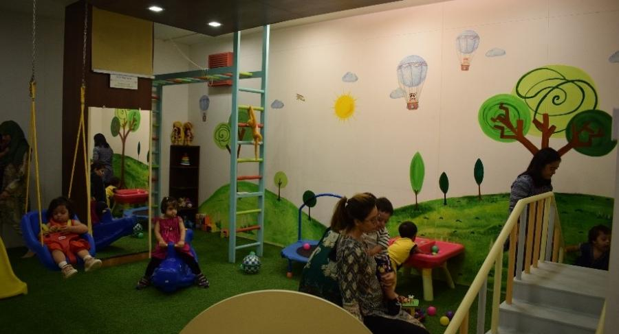 Children and teachers busy in the Early Preschool Play Area