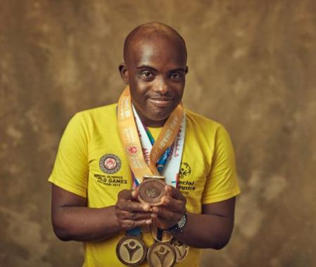 A young man with 5 gold medals
